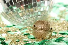 Jingle bell on the mirror ball with plate Royalty Free Stock Image