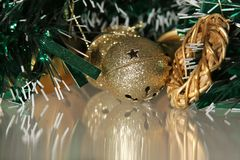 Jingle bell in the tinsel Royalty Free Stock Photo
