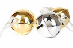 Jingle bells. A silvers and gold  jingle bells isolated on the white surface isolated on the white Stock Photo