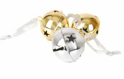 Jingle bells. A silvers and gold  jingle bells isolated on the white surface isolated on the white Stock Photography