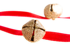 Jingle bells. On a red ribbon Stock Images