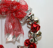 Jingle Bells. Red and Silver bells on a white door Royalty Free Stock Photos