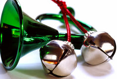 Jingle Bells. Christmas decorations - green horn and bells Royalty Free Stock Image
