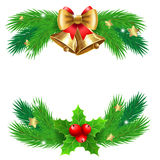 Jingle bells with  bow and fir tree branches. Royalty Free Stock Images
