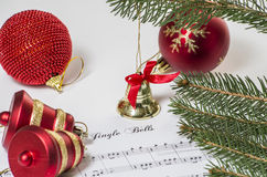 Jingle bells. Christmas decoration with a music of jingle bells and some bells Stock Photography