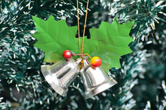 Jingle bells on Christmas tree Stock Image