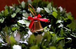 Jingle bells. Golden bell on  the tree Royalty Free Stock Image