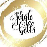 Jingle bells - hand lettering quote to winter holiday design. On golden brush stroke background, calligraphy vector illustration Stock Image