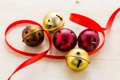 Jingle bells. Multicolor jingle bells with red ribbon Stock Photos