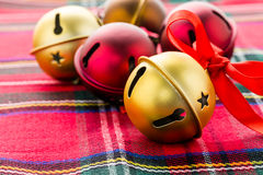 Jingle bells. Multicolor jingle bells with red ribbon Stock Image