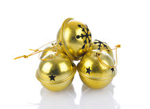Jingle Bells onWhite. A group of jingle bells on a white background with reflection Stock Image