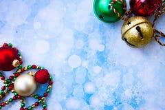 Jingle Bells and ornaments. Multi-colored jingle bells with ornaments and garland Royalty Free Stock Image