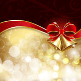 Jingle bells with red bow on a shines background Royalty Free Stock Image