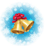 Jingle bells with red bow on winter background Royalty Free Stock Photo