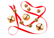 Jingle bells with red ribbon. Golden jingle bells with red ribbon Royalty Free Stock Images