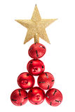 Jingle bells shaped like a Christmas tree. Christmas jingle bells and golden star shaped like a Christmas tree on an isolated white background Stock Photography