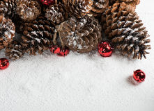 Jingle Bells with Snow and Pine Cone Stock Images