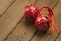 Jingle bells on wooden background stock photo