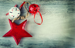 Jingle bells and wooden red star as christmas decorations. On an old wooden table - background Royalty Free Stock Image