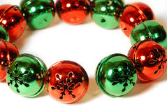 Jingle Bells Wreath. Green and red jingle bell wreath for christmas on white background Stock Photography
