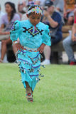Jingle Dance - Powwow 2013. A young Native American dancer performs a Jingle Dance (Prayer Dance) in the Indian Village at Cheyenne Frontier Days 2013 royalty free stock image