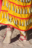 Jingle Dancer. Female Pow Wow dancer's jingles on dress and moccasins Stock Photo