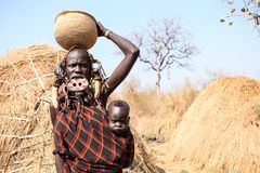 Mursi tribe lady carrying her baby stock photos