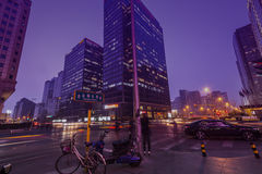 Jintong street corner. BEIJING, CHINA-CIRCA MARCH 2014:-The  evening rush as people make their way home from work, near the world trade centre Beijing Stock Photo