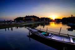 Aicent town of Jiangsu China, jinxi. Jinxi, an aicent town in Kunshan Jiangsu China. Image was shooted when sunset byside a lake. A boot in the lake, people on royalty free stock photography