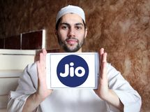 Jio , Reliance Jio Infocomm Limited logo. Logo of Jio telecommunication company on samsung tablet holded by arab muslim man. Jio is an LTE mobile network Royalty Free Stock Images