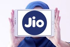 Jio , Reliance Jio Infocomm Limited logo. Logo of Jio telecommunication company on samsung tablet holded by arab muslim woman. Jio is an LTE mobile network Stock Image