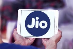 Jio , Reliance Jio Infocomm Limited logo. Logo of Jio telecommunication company on samsung tablet . Jio is an LTE mobile network operator in India. It is a Stock Photos