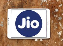 Jio , Reliance Jio Infocomm Limited logo. Logo of Jio telecommunication company on samsung tablet on wooden background. Jio is an LTE mobile network operator in Stock Image