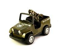 Jipe do exército dos EUA do brinquedo do verde verde-oliva. Fotografia de Stock
