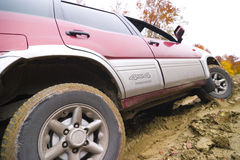 Jipe na estrada da lama Foto de Stock Royalty Free