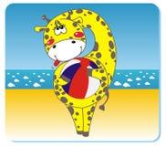 Jirafa en la playa Imagen de archivo libre de regalías