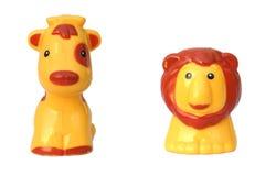 Jirafa y león Fotografía de archivo