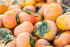 Jiri persimmons. Fresh Jiro persimmons at a fall farmer's market Stock Photography