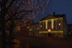 Jirkov, Czech republic - December 08, 2018: lamp, trees and houses on Dr. Emil Benes square in christmas time royalty free stock image