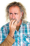 Jittery Man Biting Nails Royalty Free Stock Image