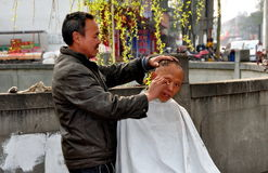 Jiu Chi Town, CH: Barber Giving Haircut Stock Photos