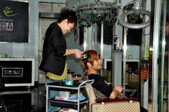 Jiu Chi Town, China: Hair Stylist at work Stock Image