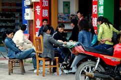 Jiu Chi Town, China: Shopkeepers Playing Mahjong Stock Photo