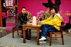 Jiu Chi Town, China: Two Youths Playing Cards Stock Photography