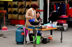 Jiu Chi Town, China: Woman Cooking Outside Royalty Free Stock Photos