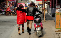 Jiu Chi Town, China: Women Walking on Street Royalty Free Stock Image