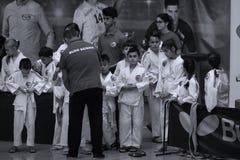Jiu Jitsu fighters with Hanshi at Romanian Championship, Juniors, May 2018. Jiu Jitsu students in Kimono with Hanshi. Jiu-Jitsu Romanian Championship took place Royalty Free Stock Photos
