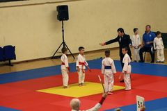 Jiu Jitsu fighters with Referee at Romanian Championship, Juniors, May 2018. Jiu Jitsu students in Kimono with Referee on tatami. Jiu-Jitsu Romanian Championship Stock Images