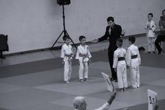 Jiu Jitsu fighters with Referee at Romanian Championship, Juniors, May 2018. Jiu Jitsu students in Kimono with Referee on tatami. Jiu-Jitsu Romanian Championship Stock Photos