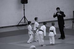 Jiu Jitsu fighters with Referee at Romanian Championship, Juniors, May 2018. Jiu Jitsu students in Kimono with Referee on tatami. Jiu-Jitsu Romanian Championship Royalty Free Stock Image